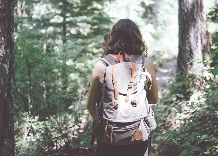 girl-walking-in-woods