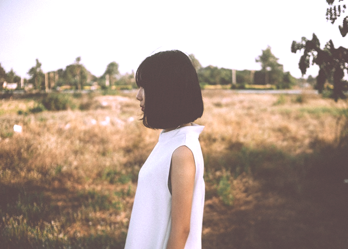 girl-standing-in-field
