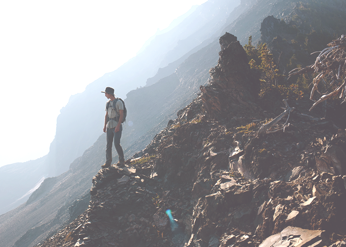 guy-standing-on-cliff