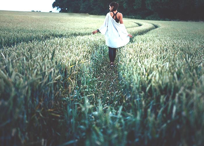 tfd_photo_woman-walking-in-field