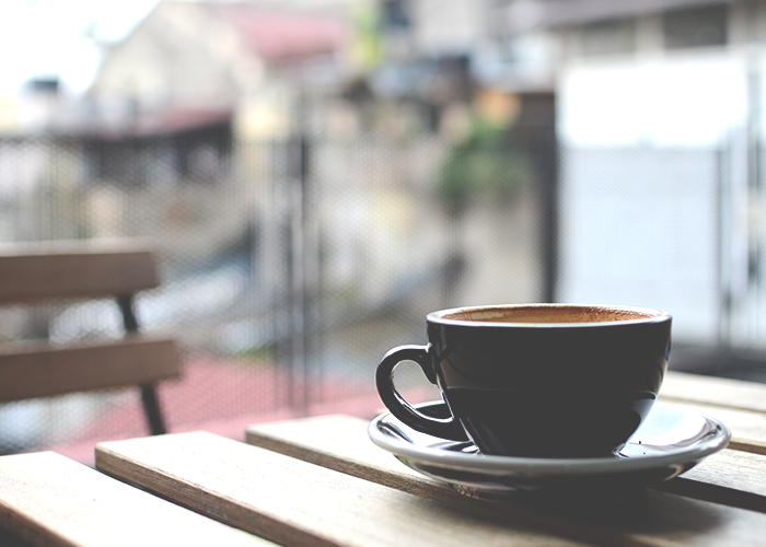 tfd_photo_black-coffee-cup-in-saucer_empty-table