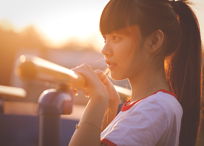 tfd_asian-woman-looking-out-in-sun