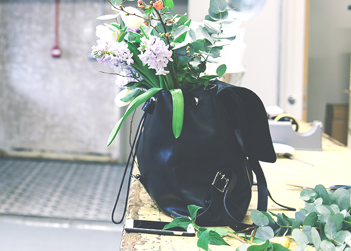 tfd_black-leather-bag-flowers-and-phone