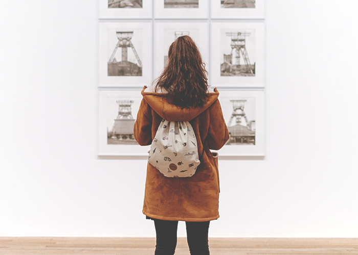 tfd_woman-in-museum-looking-at-art