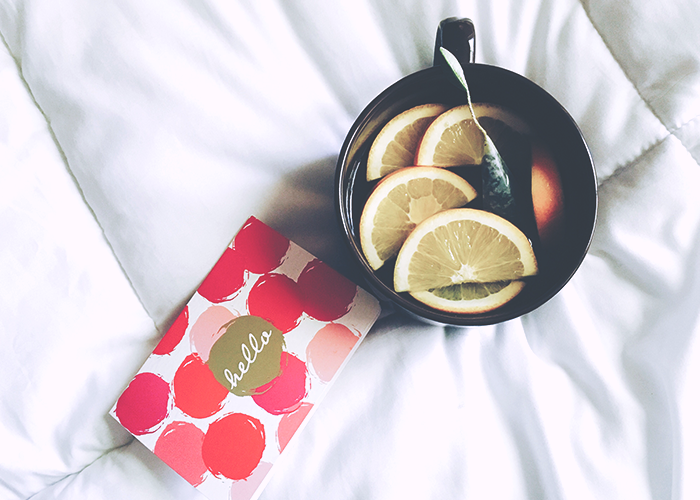 tea-and-card-on-bed