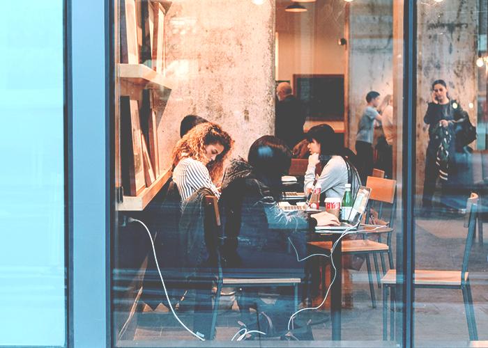 women-in-cafe-working