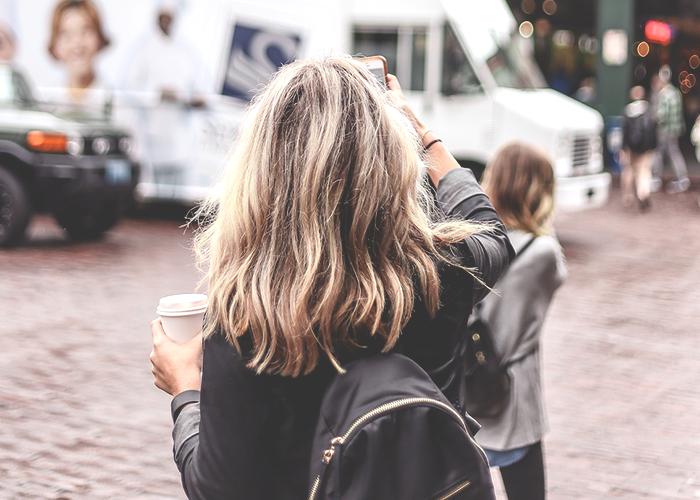 tfd_girl-standing-near-public-market-seattle-sign