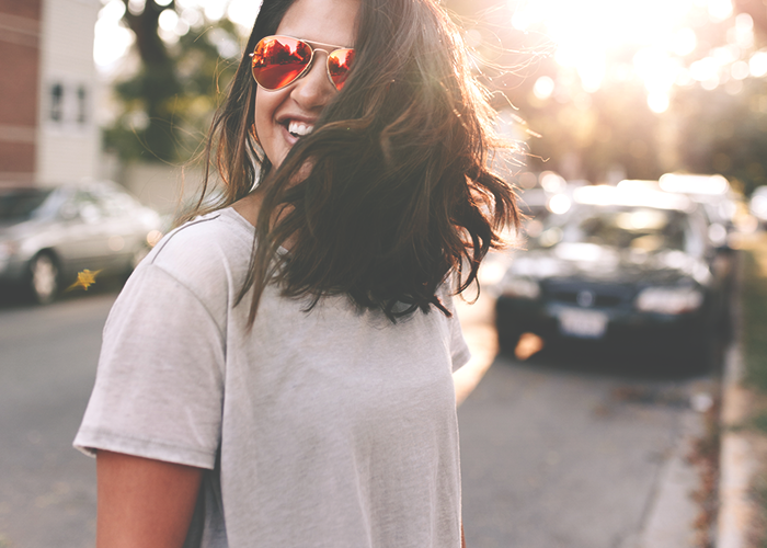 tfd_woman-laughing-in-sunglasses