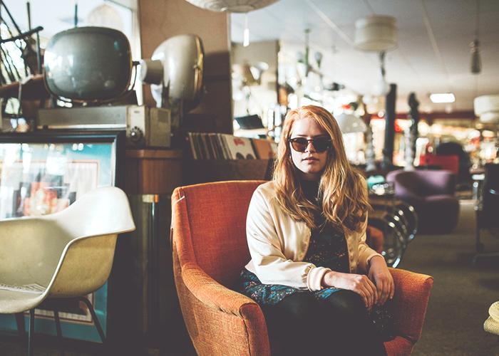 tfd_woman-sitting-in-armchair-in-vintage-store