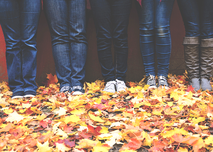 people-standing-in-the-leaves-side-by-side
