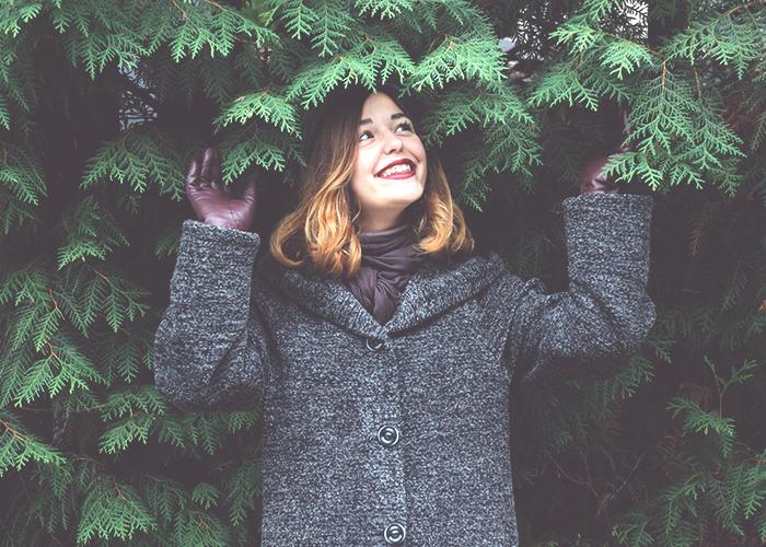 woman-standing-under-fir-tree