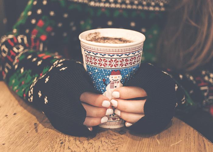 womans-hands-on-mug-of-hot-chocolate