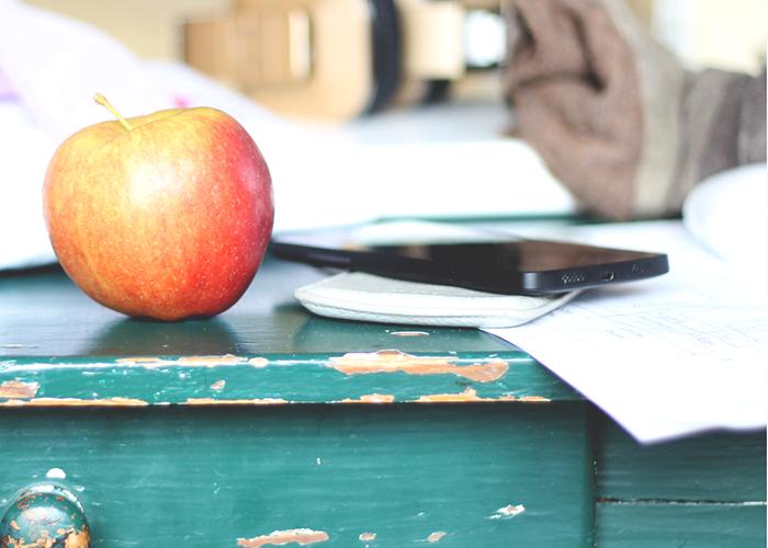 teachers-desk-with-apple-and-phone