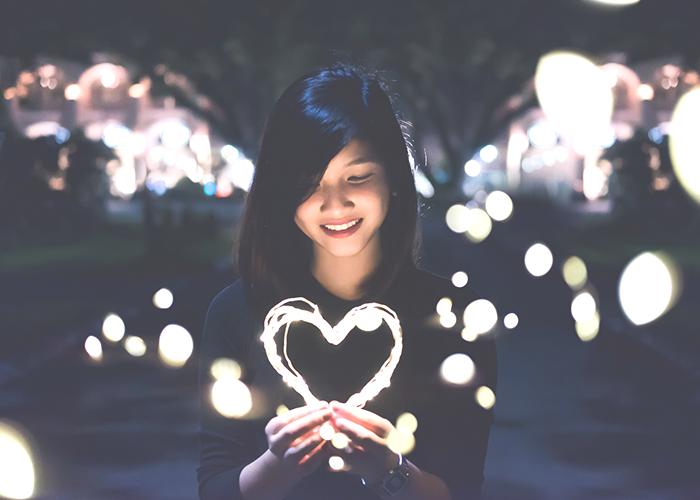 woman-holding-a-light-heart