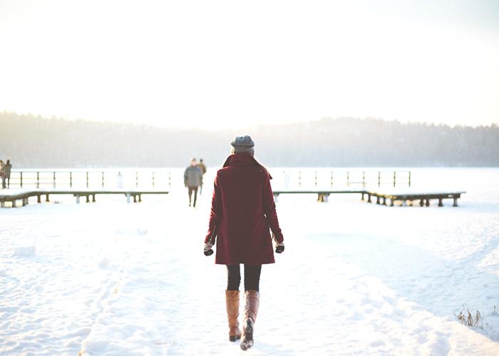 woman-walking-in-snow-outside